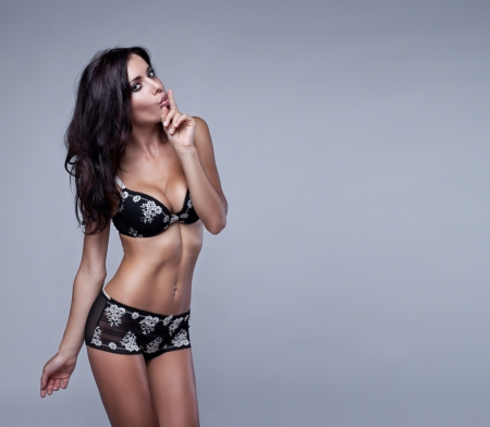 Sexy brunette woman in lingerie Stock Photo