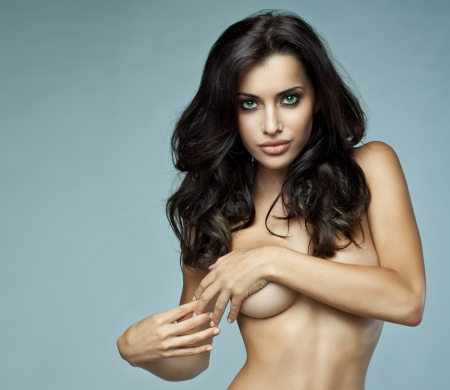 lingerie model: Portrait of beautiful brunette woman without bra Stock Photo