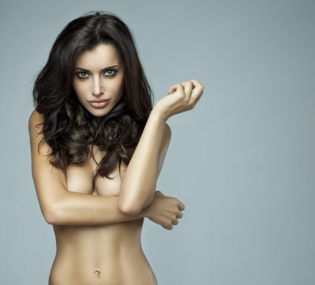 without: Portrait of beautiful brunette woman without bra Stock Photo