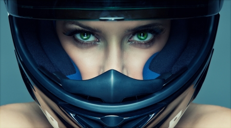 motorcyclist: Sexy woman in helmet on blue background Stock Photo