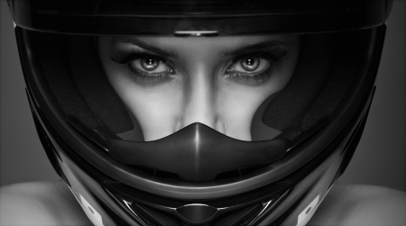 race car driver: black and white  sexy woman in helmet on the background Stock Photo