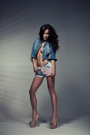 vogue: Sexy brunette woman in studio