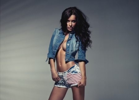 Sexy brunette woman in studio photo