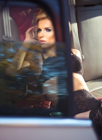 Sexy lady in a sport car Imagens