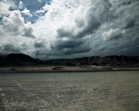 fissures: landscape with storm clouds Stock Photo