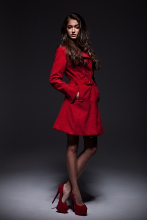 elegance: Young woman in a fashion coat
