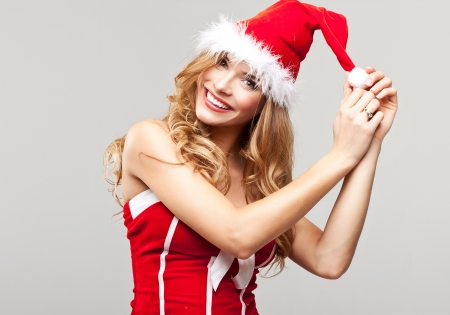 surprise face: Beautiful happy woman in Santa Claus clothes