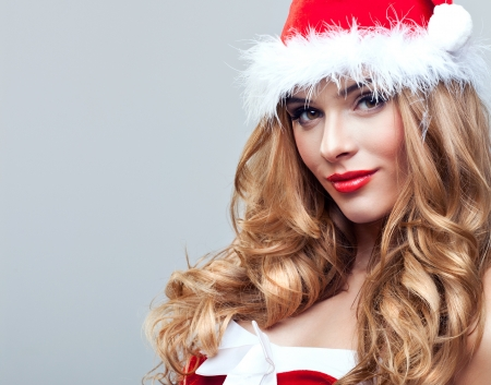 Beautiful happy woman in Santa Claus clothes photo