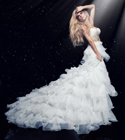 white dress: Sexy blond woman in white dress  Stock Photo