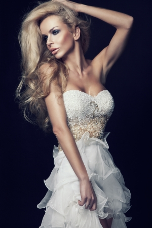 chic woman: Cute blond woman in white wedding dress