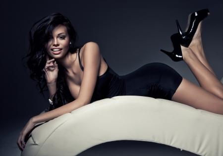 shoe model: Portrait of beautiful happy brunette woman
