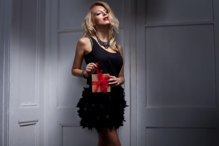 Sexy blonde woman with a gift  photo
