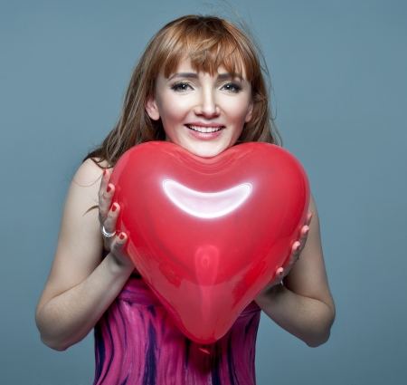 Valentines Day  Woman holding Valentines Day heart  photo