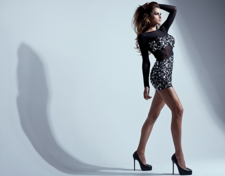 Pretty young lady with long legs in a fashion pose  photo