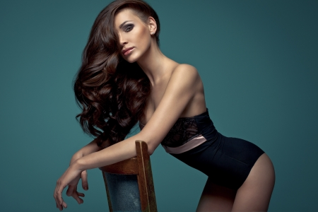 Vogue style photo of very delicate brunette woman  photo