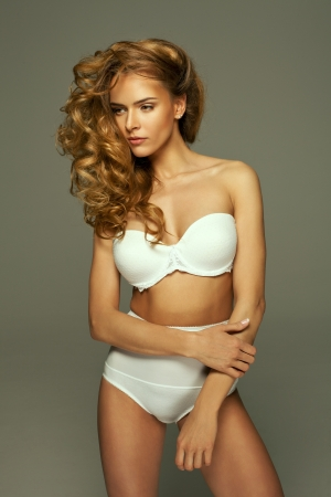 Sexy woman in white lingerie with natural make-up Stock Photo - 19754177