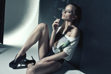 hot girl: Fashion photo of sexy woman smoking a cigarette