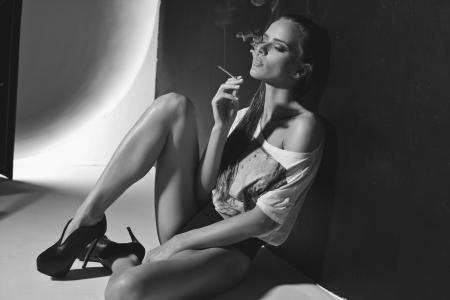 shoe model: Fashion photo of sexy woman smoking a cigarette