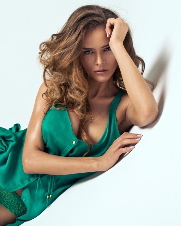 young girls breast: Portrait of attractive young woman in green dress with decolletage