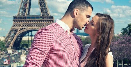 hugs and kisses: Loving couple in romantic city Stock Photo