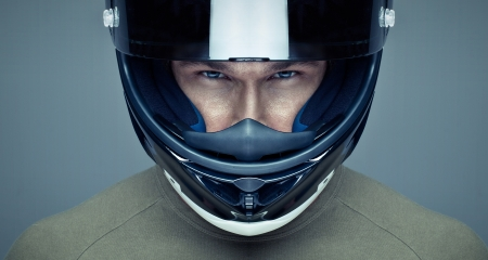 blue helmet: Handsome man in helmet on blue background