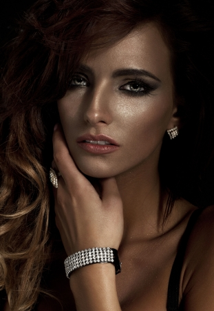 Fashion portrait of young beautiful woman with diamond jewelry photo