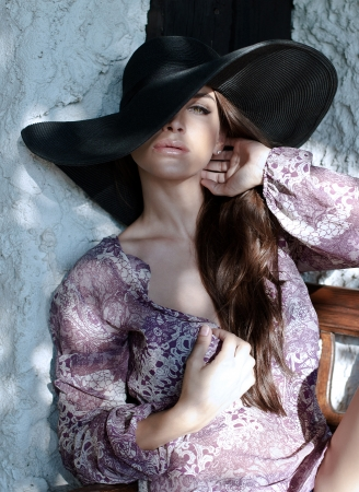 Woman with black hat Stock Photo - 21824032