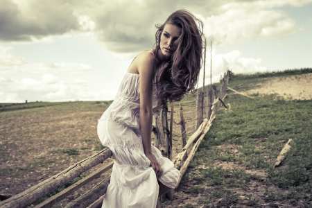 Young woman in white dress outdoor  photo