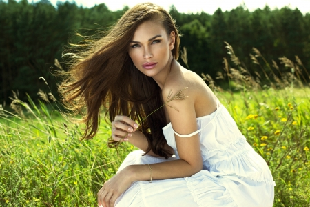 Woman resting on meadow photo
