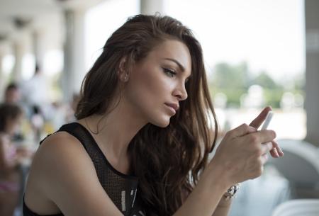 pretty girl: Woman sending a text message