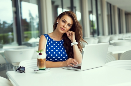 adult sexy: Beautiful smiling woman working on laptop