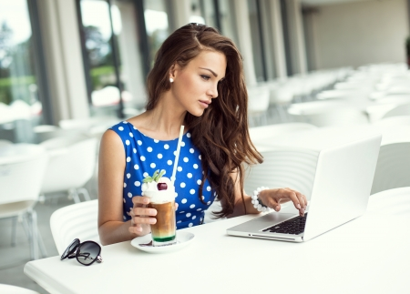 working dress: Beautiful woman working on laptop