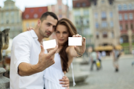 discount card: Portrait of blured couple showing white card