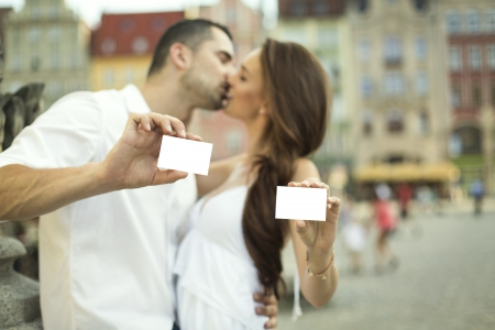 Kissing couple showing white card photo