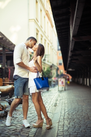 Couple in love kissing each other in city center photo