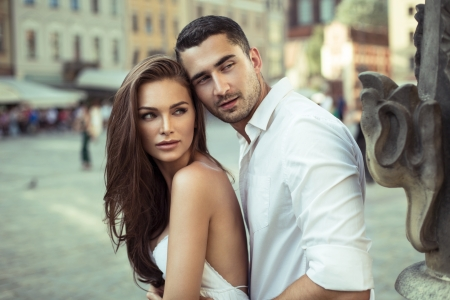 engaged: Beautiful young couple on vacation