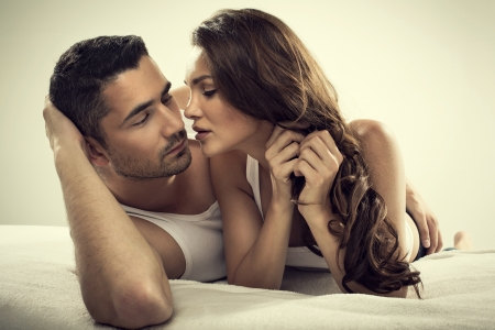 sex on bed: Handsome man and sexy woman in bed Stock Photo
