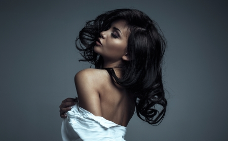 Sensual woman with closed eyes photo