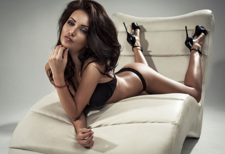 Brunette beauty lying  photo