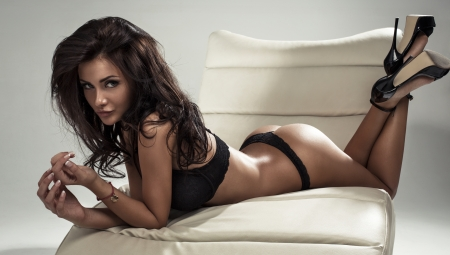 Beautiful woman lying on stomach photo