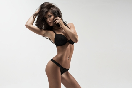 Fashion woman in black lingerie photo