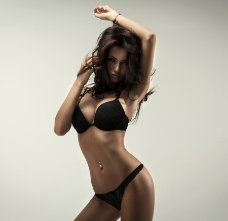 sexy hands: Beautiful brunette beauty in black underwear Stock Photo