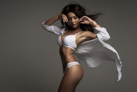 Brunette beauty wearing white floating shirt photo