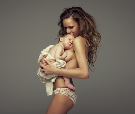 Young mother kissing baby photo