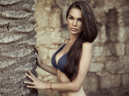 pal: Female model posing near the pal Stock Photo