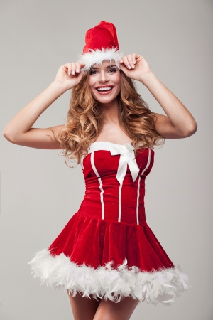 Attractive young happy woman wearing santa claus costume  Stock Photo - 24502082