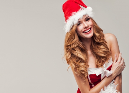 Smiling girl insanta clause costume photo