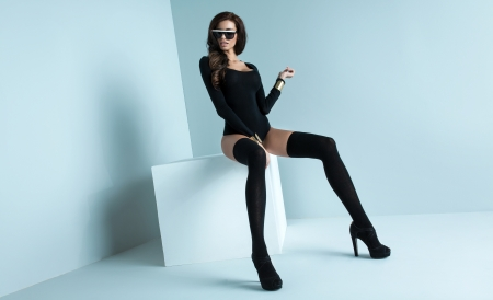 Rrefined woman wearing black stockings photo
