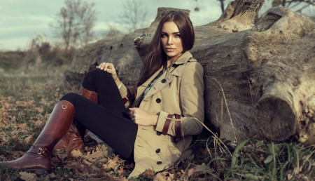 Young girl sitting outdoor in autumn scenery photo