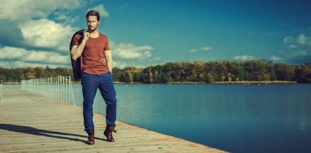 young man portrait: Panoramic photo of handsome man on the lake